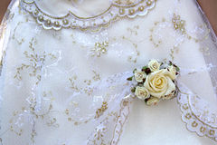 Dress detail. Wedding detail from bride's dress, white rose Stock Photo