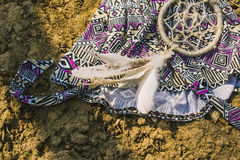 Dress, dreamcatcher lying on dry land. hipster style Royalty Free Stock Image