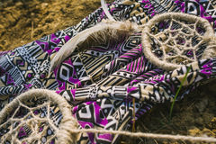 Dress, dreamcatcher  lying on dry land. hipster style Royalty Free Stock Images