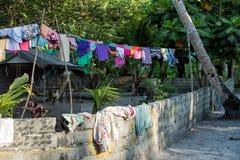 Dress driying outside poor hovel, shanty, shack Stock Image