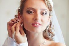 Dress earrings. Royalty Free Stock Photos