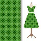 Dress fabric with green arabic pattern Stock Photos