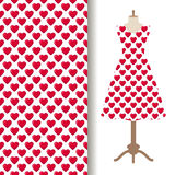 Dress fabric with red hearts pattern. Women dress fabric pattern design on a mannequin with red glossy sweetie hearts Royalty Free Stock Photography