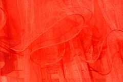 Dress folds. Red dress folds pointing out transparency and imponderability royalty free stock images