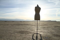 Dress form. On dry lakebed Royalty Free Stock Photos