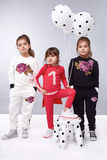 Dress girl clothing small collection cute. Small baby girls sisters in a beautiful style fashion clothes collection of dress suit silk skirt, holding balloons Royalty Free Stock Images