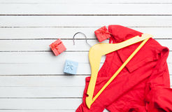 Dress with hanger and gifts Royalty Free Stock Photography