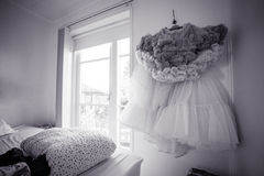 Dress haning in a bedroom Royalty Free Stock Image