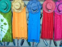 Dress and hat sale. Colored dresses and hats to sale in the summer - Brazil Royalty Free Stock Photo