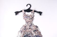A dress made of metafan on a black coat hanger. stock photography