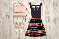 Dress in ornament, white shoes and beige bag. Fashionable concept Royalty Free Stock Images