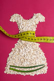 Dress shape made from oatmeal with measuring tape Stock Photography