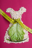 Dress shape made from oatmeal with measuring tape Stock Image