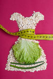 Dress shape made from oatmeal with measuring tape Stock Photo