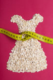 Dress shape made from oatmeal with measuring tape Stock Photos