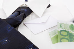 Dress shirt, envelope and money. Business. Royalty Free Stock Images
