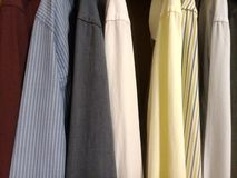 Dress shirts in the closet - colors. Dress shirts in the closet - various colors and striped shirts royalty free stock photography