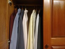 Dress shirts in the closet royalty free stock photo