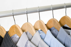 Dress Shirts on Hangers. Dress shirts on wooden hangers Royalty Free Stock Images
