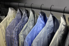 Dress Shirts Hanging on Hangers in Closet Royalty Free Stock Photo