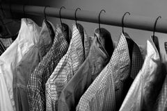 Dress Shirts Hanging on Hangers in Closet Stock Images