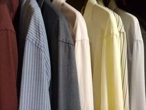 Dress shirts in the male closet stock images