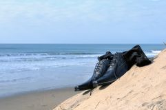 Dress shoes on the beach Stock Photo
