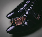 Dress shoes and a watch. Black man's shoes and watches Royalty Free Stock Photo