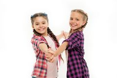 Dress similar with best friend. Dress to match your friend. Best friend dressing. Girls friends wear similar outfits. Have same hairstyle kanekalon braids white stock images