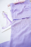 Dress and sketch paper. Beautiful lilac dress with pearls. dress and sketch paper in a sewing workshop Royalty Free Stock Images