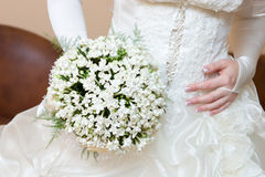 Dress and snowdrop flower bouquet Royalty Free Stock Photo