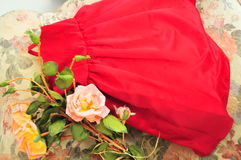 Dress with some older roses. Getting ready for an event Stock Image