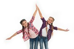 Dress to match your friend. Best friend dressing. Girls friends wear similar outfits have same hairstyle kanekalon. Braids white background. Sisters family look royalty free stock photos