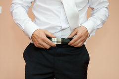 Dress up a belt with buckle Stock Photography