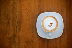 Dress up of cappuccino coffee in white cup on brow Royalty Free Stock Photo