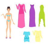 Dress up doll with summer dresses Stock Photos
