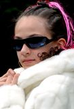 Dress up preteen. This a picture of my Eleven year old daughter after playing dress up at a birthday party with her friends. I added my sunglasses Stock Photography