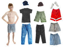 Dress-Up Teen Clothes. A young white Caucasian adult wearing underwear isolated on white with a bunch of clothes on the right. Mix and match! You can place the Stock Photo