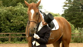 Dressage rider with her horse stock footage