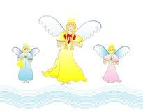 Dressed angelic family Stock Photos