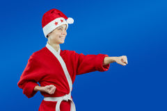 Dressed as Santa Claus athlete beats punch arm Stock Image
