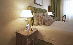 Dressed bed with bedside table Stock Photo