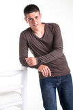 Dressed in brown shirt and blue jeans. Royalty Free Stock Photography