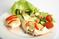 Dressed crabs on dinner plate Stock Image