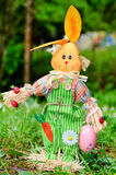 Dressed Easter bunny for decoration in a green spring  garden Royalty Free Stock Photo