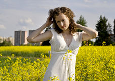 Dressed girl on nature. Beautiful curly girl on nature Stock Images