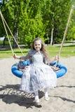 Dressed like princess girl on a swing Stock Photography
