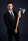 Dressed man shows an ax Stock Photo