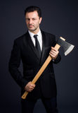 Dressed man shows an ax Royalty Free Stock Photography