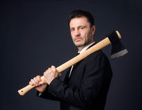 Dressed man shows an ax Royalty Free Stock Photo
